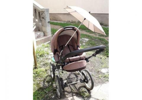 Umbrela universală pentru orice carucior